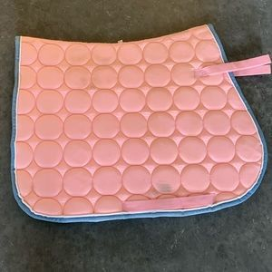 Baby pink with blue trim saddle pad
